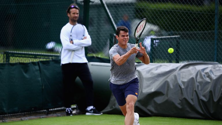 Carlos Moya watches on as Milos Raonic practices at Wimbledon