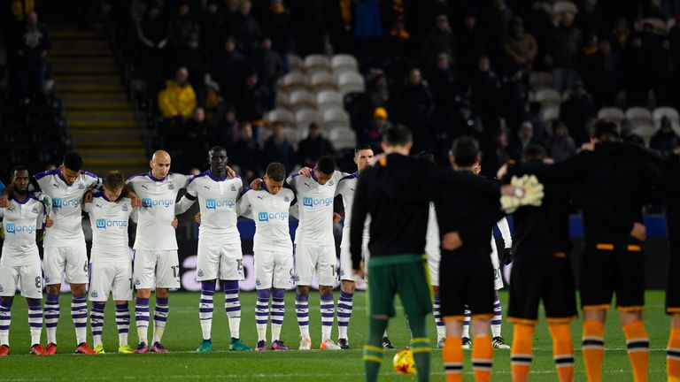 Newcastle and Hull players observe a minute's silence for the victims of the plane crash involving the Brazilian club Chapecoense