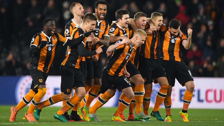 Hull City players celebrate following victory over Newcastle in the penalty shootout