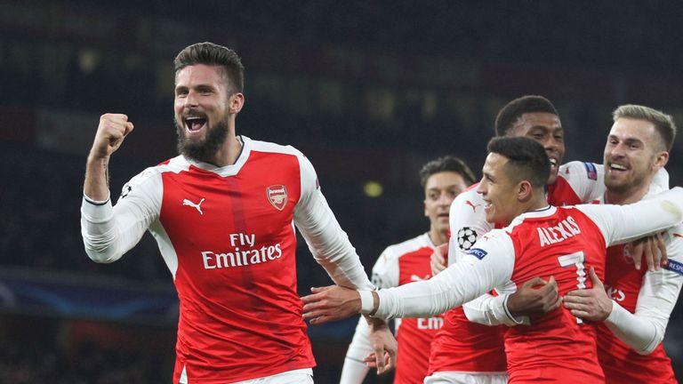 Arsenal striker Olivier Giroud celebrates after scoring from the penalty spot against PSG
