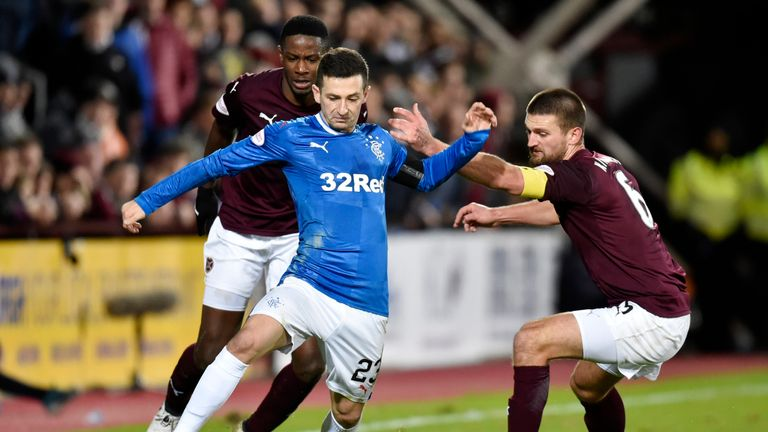 Rangers' Jason Holt runs from Hearts duo Arnaud Djoum (left) and Perry Kitchen