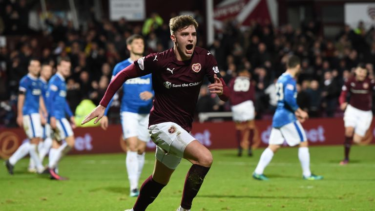 Robbie Muirhead celebrates after putting Hearts ahead against Rangers