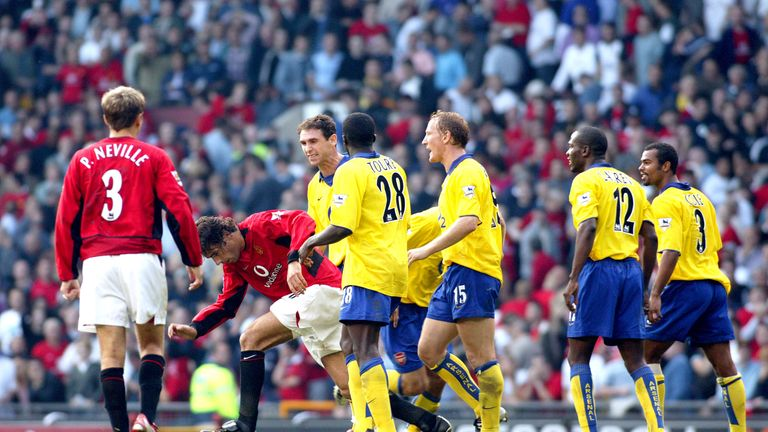 Martin Keown and Parlour taunt Ruud van Nistelrooy following his penalty miss in the 'Battle of Old Trafford' in September 2003