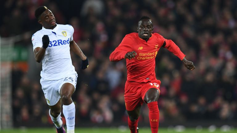 Leeds United's Hadi Sacko (L) vies with Liverpool's Sadio Mane during the EFL Cup quarter-final