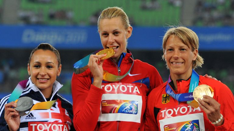 2011 gold medallist Russia's Tatyana Chernova (C) poses with silver medallist Ennis (L) and bronze medallist Germany's Jennifer Oeser (R)