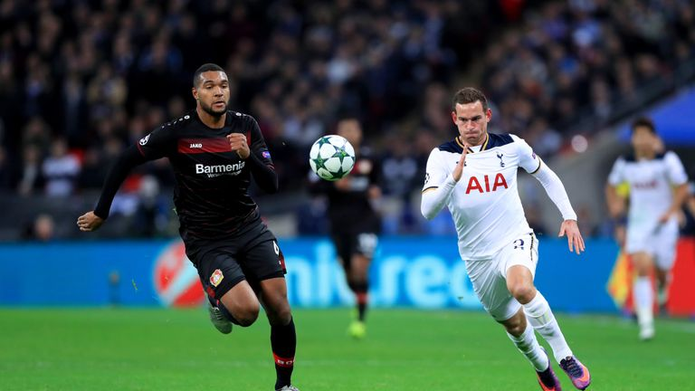 Jonathan Tah and Vincent Janssen chase down a pass