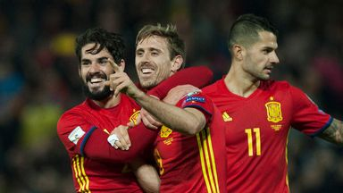 Spain's defender Nacho Monreal (C) celebrates with teammates after scoring in the World Cup Qualifier against Macedonia