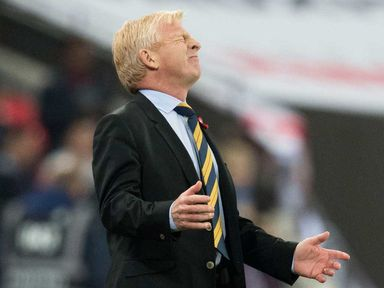 Gordon Strachan winces as a chance goes begging against England at Wembley