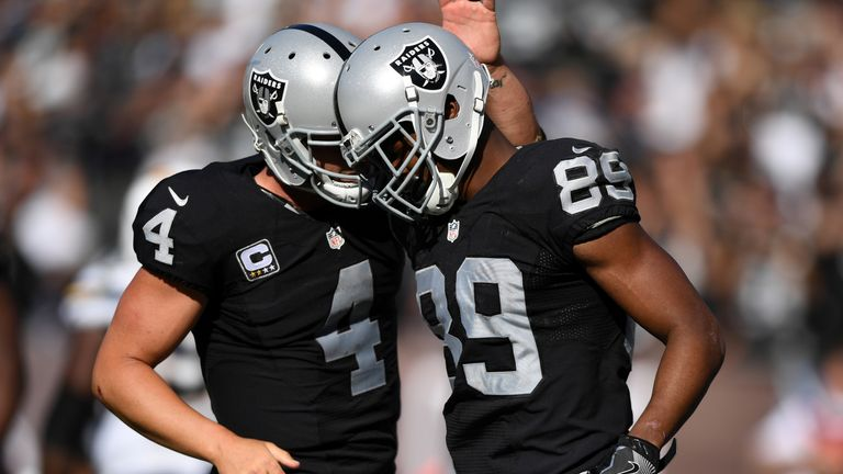OAKLAND, CA - OCTOBER 09:  Derek Carr #4 of the Oakland Raiders celebrates with Amari Cooper #89 after a scoring on a two-point conversion against the San