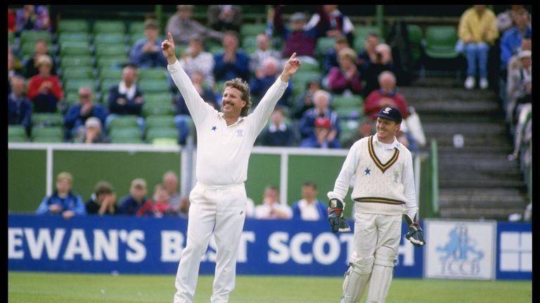 Ian Botham salutes the crowd in his final game before retiring in 1993