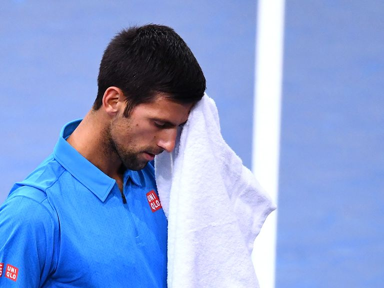 Djokovic comes from behind to win ATP finals opener