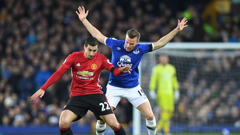 Henrikh Mkhitaryan (left) vies with Cleverley