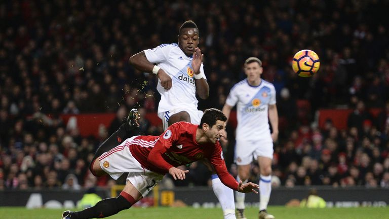 Henrikh Mkhitaryan scores Manchester United's third goal with an acrobatic effort
