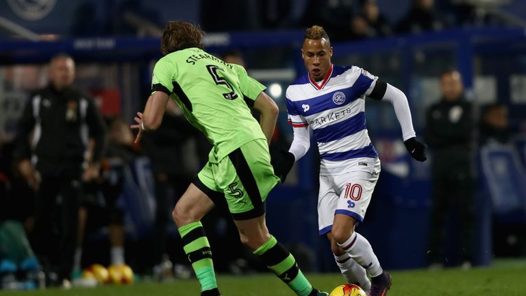 Tjaronn Cherry of QPR (right) attempts to take the ball past Wolves defender Richard Stearman