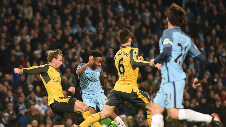 Raheem Sterling's low strike gives Manchester City the lead
