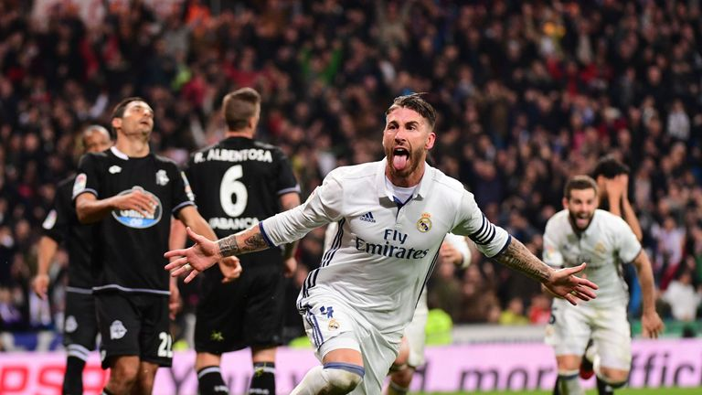 Real Madrid's defender Sergio Ramos celebrates after scoring against Deportivo