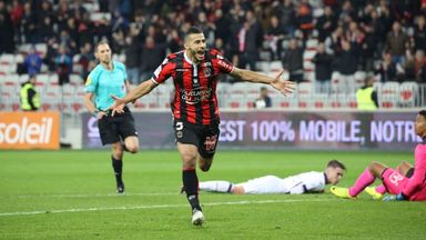 Younes Belhanda wheels away in celebration after doubling Nice's lead against Toulouse