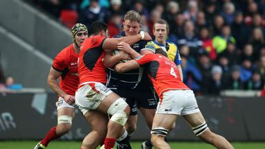 Sale's Ross Harrison is tackled by Saracens' Mike Rhodes