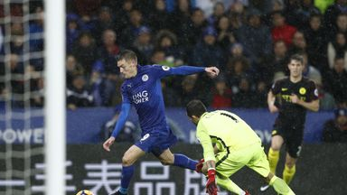 Leicester City's striker Jamie Vardy scores his third goal against Man City