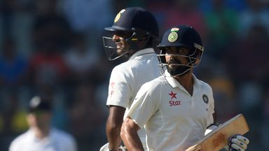 India's captain Virat Kohli (R) and teammate Jayant Yadav run between the wickets on the fourth day of fourth Test cricket match between India and England