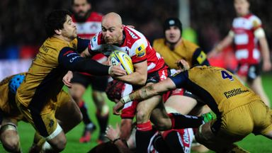 Will Heinz is tackled by Jon Fisher of Bristol