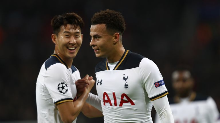 LONDON, ENGLAND - DECEMBER 07: Dele Alli of Tottenham Hotspur (R) celebrates scoring his sides first goal with Heung-Min Son of Tottenham Hotspur (L) durin