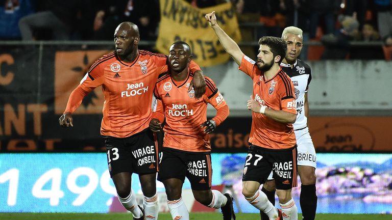 Abdul Waris (C) celebrates after scoring for Lorient