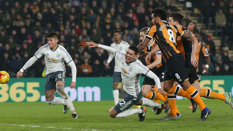 Chris Smalling of Manchester United is brought down by Tom Huddlestone of Hull City but no penalty is given
