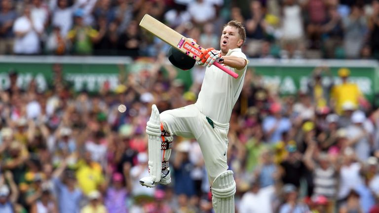 Australia's David Warner celebrates scoring a century in the first session against Pakistan at the SCG