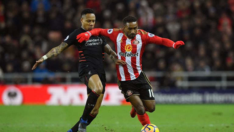 Nathaniel Clyne of Liverpool (L) and Jermain Defoe of Sunderland (R) battle for possession
