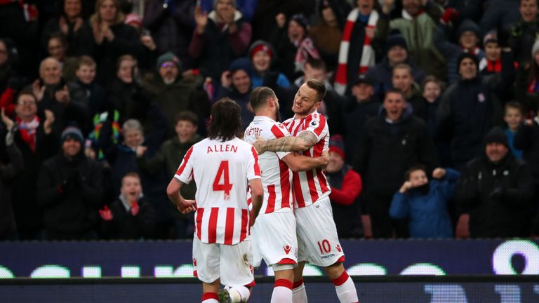 Stoke celebrate going 1-0 up at the Bet365 Stadium through Juan Mata's own goal