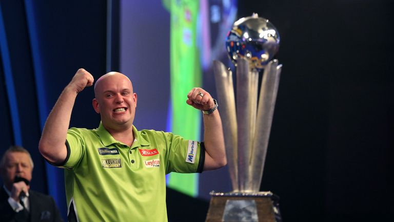 Michael van Gerwen celebrates winning with Sid Waddell trophy