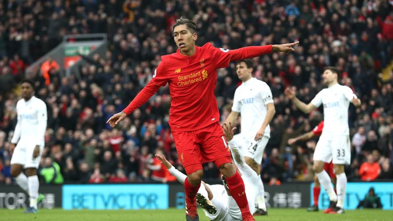 Roberto Firmino of Liverpool celebrates scoring his side's first goal