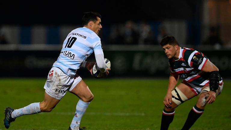 Dan Carter runs at Leicester forward Mike Williams