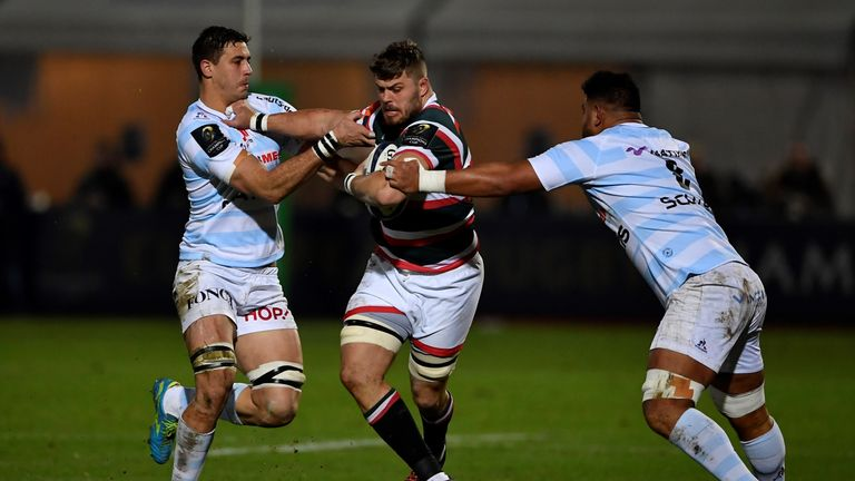 Ed Slater is tackled by Racing 92 duo So'otala Fa'aso'o (R) and Gerbrandt Grobler