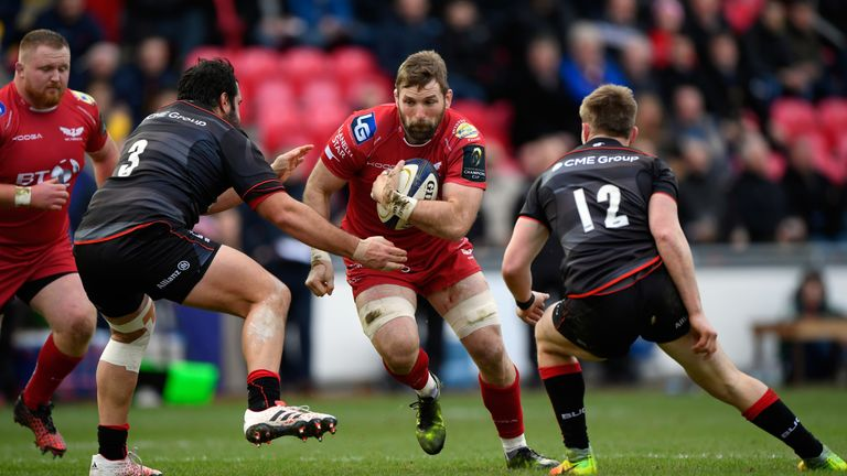 Scarlets number 8 John Barclay runs at the Saracens defence