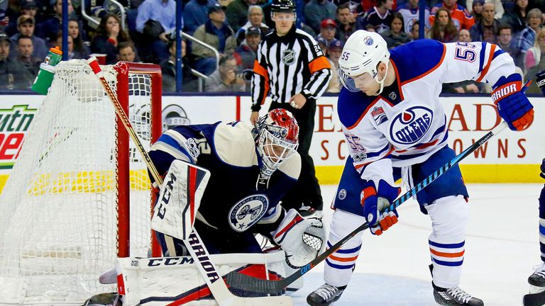 Sergei Bobrovsky makes one of his 21 saves to keep Mark Letestu from scoring for the Oilers