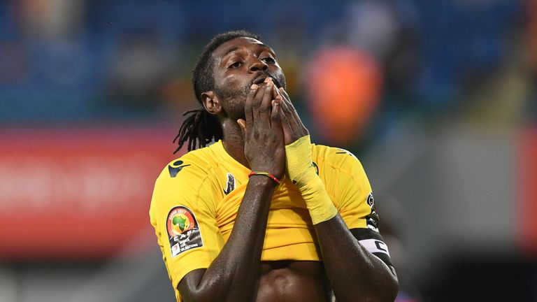 Togo forward Emmanuel Adebayor reacts after missing a goal opportunity