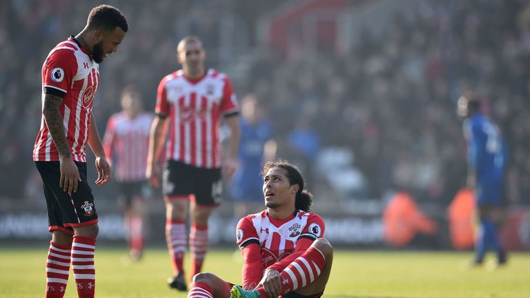 Southampton's Dutch defender Virgil van Dijk (C) sits down injured
