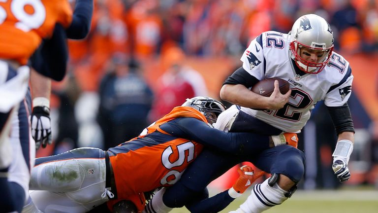 Tom Brady #12 of the New England Patriots is sacked by  Von Miller #58 of the Denver Broncos