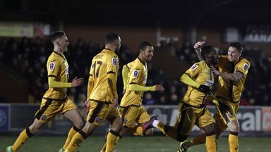 Sutton United's Roarie Deacon (2nd R) celebrates his equaliser with team-mates