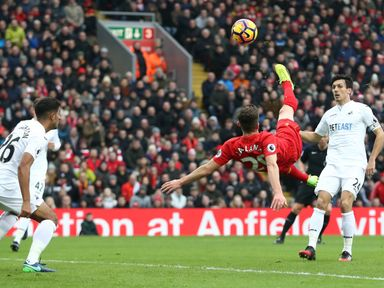 Adam Lallana goes for goal against Swansea