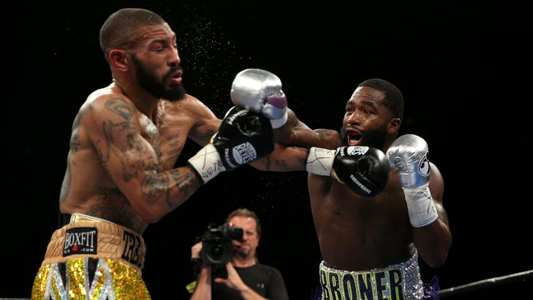 WASHINGTON, DC - APRIL 01: Ashley Theophane (L) and Adrien Broner exchange punches in their super lightweight championship bout at the DC Armory on April 1