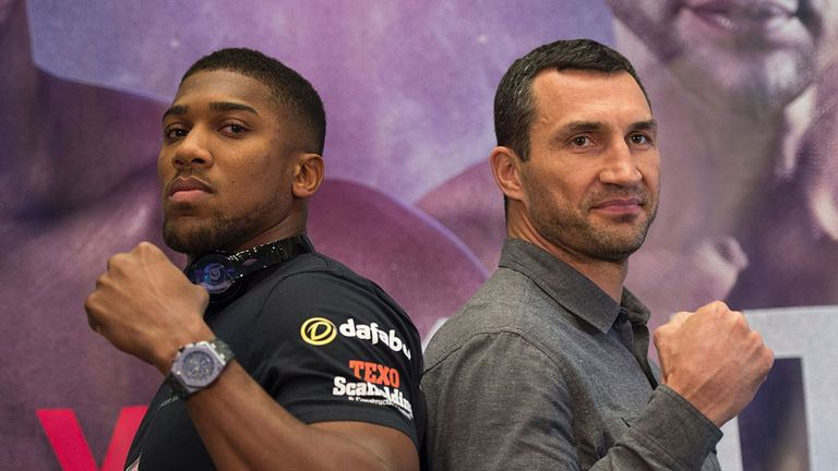 British boxer Anthony Joshua(L) and Wladimir Klitschko of the Ukraine meet during a news conference January 31, 2017 in Madison Square Garden