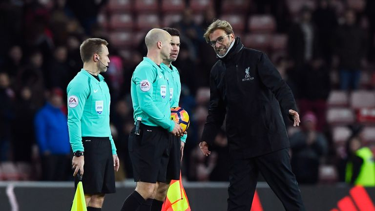 Referee Anthony Taylor speaks to Jurgen Klopp after the 2-2 draw at the Stadium of Light