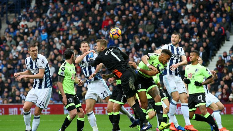 Artur Boruc (right) attempts to punch the ball but misses which leads to West Brom's second