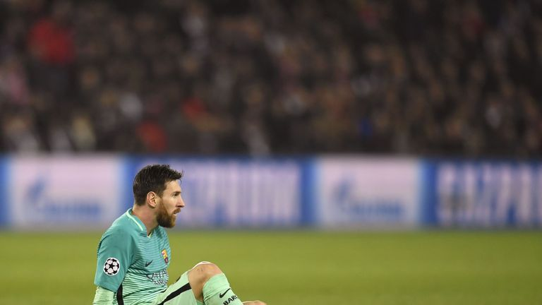 Lionel Messi shows his dejection during Barcelona's defeat to PSG