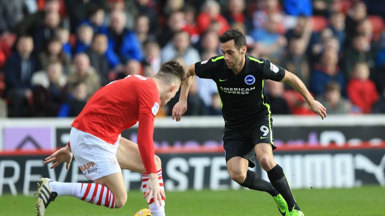 Barnsley's Angus MacDonald (left) and Brighton's Sam Baldock battle for the ball