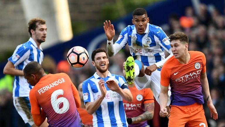 John Stones heads clear under pressure