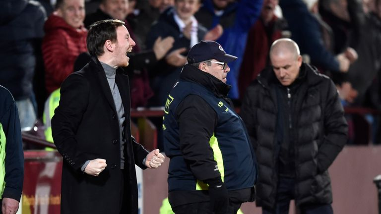 Hearts head coach Ian Cathro celebrates as Rangers manager Mark Warburton looks dejected